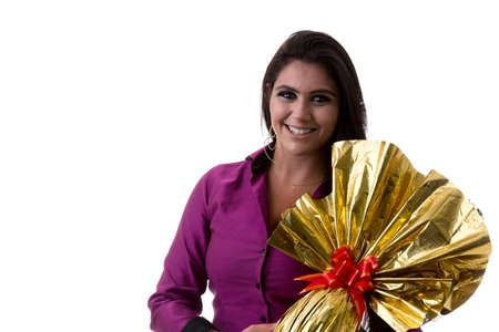 brazilian woman: Happy Brazilian woman holding Easter Egg