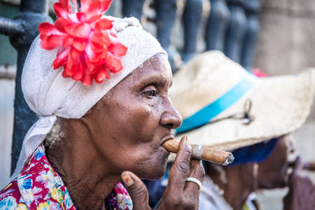 Portrait of african cuban women smoking cigar in Havana, Cuba