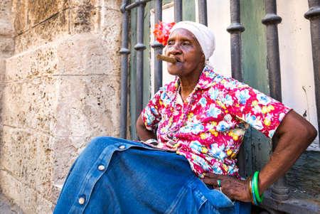 elderly women: Portrait of african cuban woman smoking cigar in Havana, Cuba