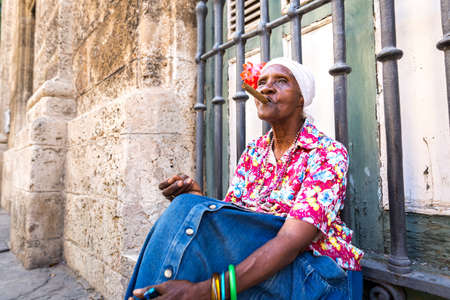cuban culture: Portrait of african cuban woman smoking cigar in Havana, Cuba