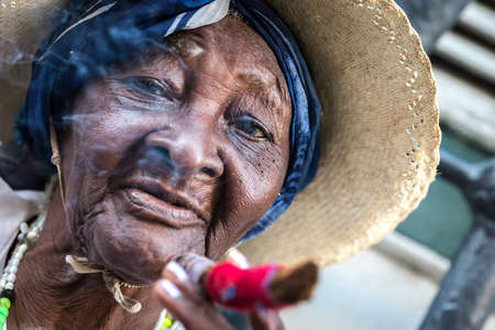 woman street: Portrait of african cuban woman smoking cigar in Havana, Cuba