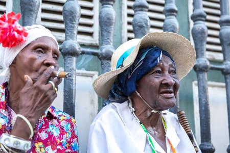ethnic women: Portrait of african cuban woman smoking cigar in Havana, Cuba