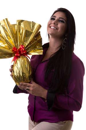 bunny girl: Happy Brazilian woman holding Easter Egg
