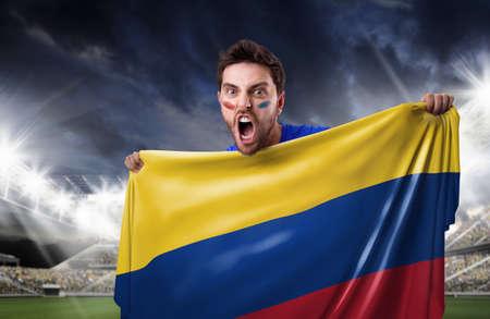 cerillos: Ventilador de la celebración de la bandera de Colombia en el estadio Foto de archivo