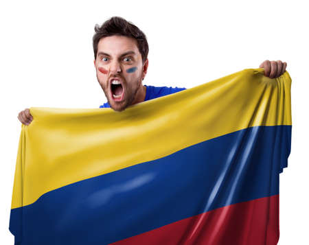 Fan holding the flag of Colombia on white background Stock Photo