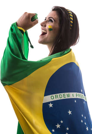 Brazilian woman fan holding the flag of Brazil on white background Stock Photo