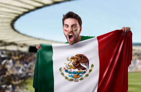 look latino: Fan holding the flag of Mexico Stock Photo