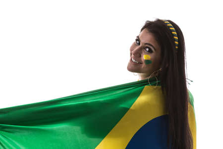 Brazilian woman fan holding the flag of Brazil on white background Stock Photo