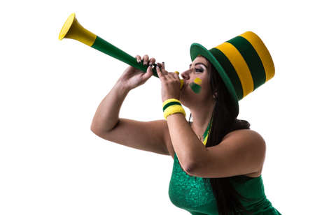 vuvuzela: Brazilian woman fan blowing by vuvuzela on white background