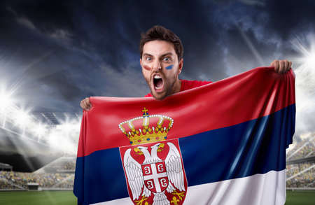 serbia: Fan holding the flag of Serbia