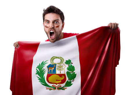 Fan holding the flag of Peru Stock Photo