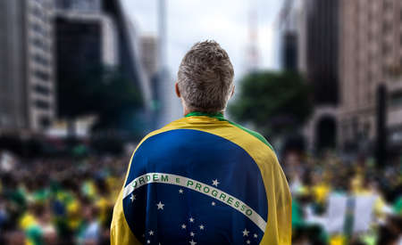 Brazilian holding the flag of Brazil in Paulista Avenue Stock Photo