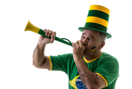 vuvuzela: Brazilian old man fan blowing by vuvuzela on white background