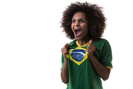 brazilian woman: Brazilian woman fan celebrating on white background Stock Photo