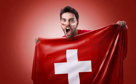 ted: Fan holding the flag of Switzerland on ted background