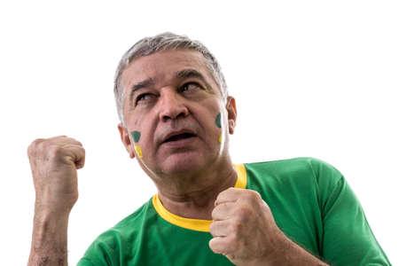 senior olympics: Brazilian old man fan celebrating on white background Stock Photo
