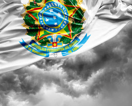 brazilian flag: Brazilian coat of arms waving flag on a bad day