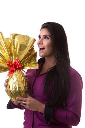latina america: Happy Brazilian woman holding Easter Egg