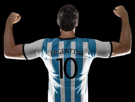 argentine: Argentine soccer player black background Stock Photo