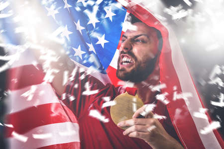 American fan holding the national flag Stock Photo
