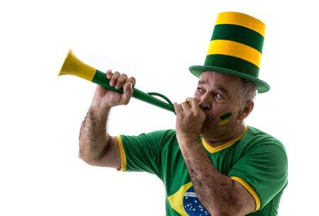Brazilian fan blowing a vuvuzela