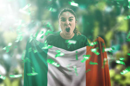 Female soccer fan with Italy flag in stadium