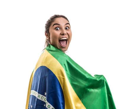 Female soccer fan with Brazil flag
