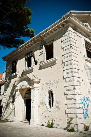 Abandoned dirty demolished building, one of hotels in Kupari complex near Dubrovnik Sajtókép