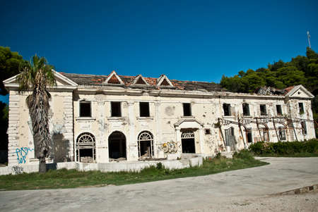 Abandoned dirty demolished building, one of hotels in Kupari complex near Dubrovnik Editorial