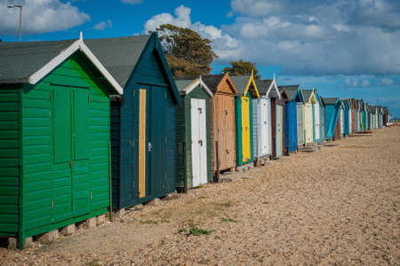 2016 United Kingdom Mersea colorful houses on the coast. Beautiful beach with interesting buildings Stock Photo