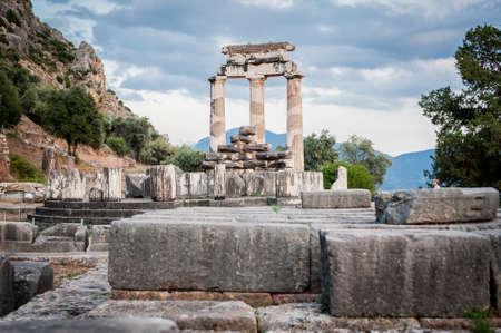 delphi: Upper Central Greece, August 2015, Delphi ancient sanctuary - The Delphic Tholos Stock Photo