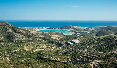 Greece, Crete, view to the green hills and sea, olives trees and bay