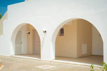 Greek architecture - white buildings, sea and blue windows