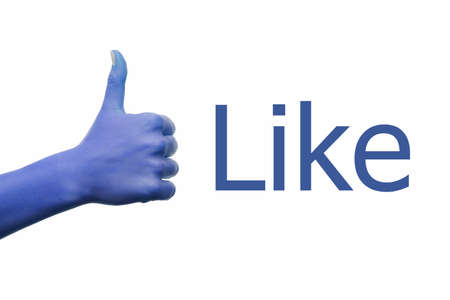 likes: Blue facebook hand showing thumbs up and inscription Like Stock Photo