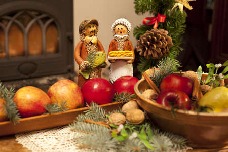 Xmas composition with figures, apples and needles photo