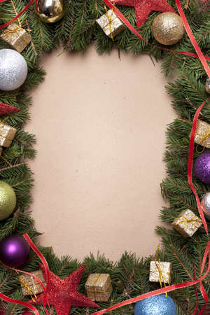 Hand made christmas paper with tree border with christmas decoration photo