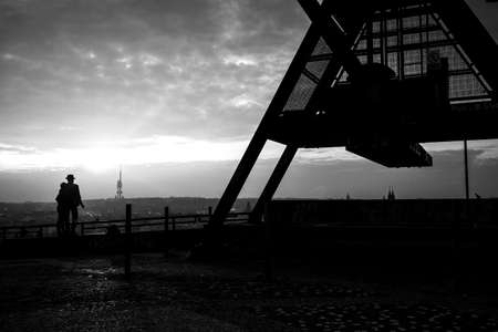 metronome: Lovers standing at the Prague Metronome, black and white, Czech Republic