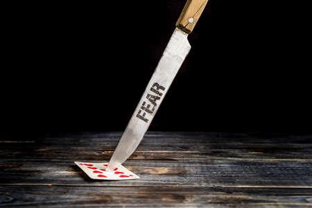Knife with title FEAR. Standard-Bild