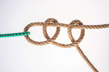 Two Half Hitches Knot isolated on white background . Node rope.
