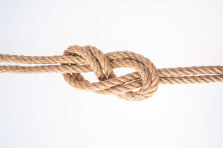 Double Figure Eight knot on white background. Rope node Imagens