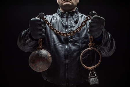 Serial killer with chains for his victim / Halloween concept Stock Photo