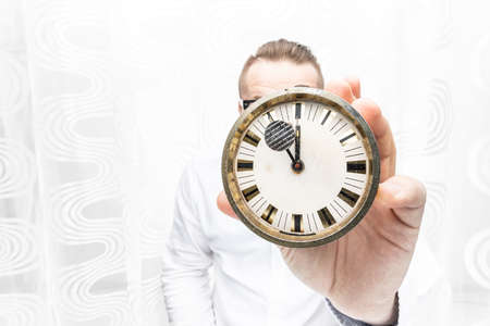 A frightened and surprised man has to do things right now and he does not have time for it. He says he does not have time. Do it now, stop time concept. Reklamní fotografie