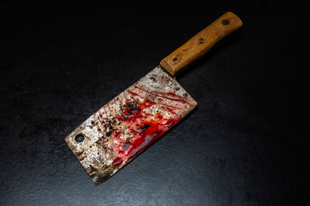 Serial killer tools  bloody meat cutter Фото со стока