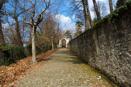The cobbled road leading to the Sacred Mountain of Orta's Saint Julio in Italy