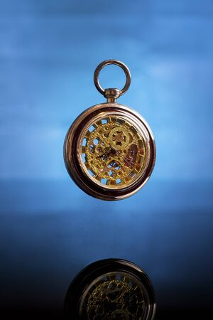 old pocket watch suspended in time