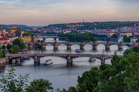 Scenic view over Prague bridges and Vltava River from Letna Hill at dusk. Beautiful view of Prague's Old Town. Prague, Czech Republic