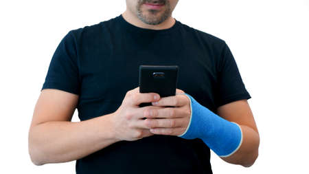 synthetic  cast hand holds phone on white background Imagens