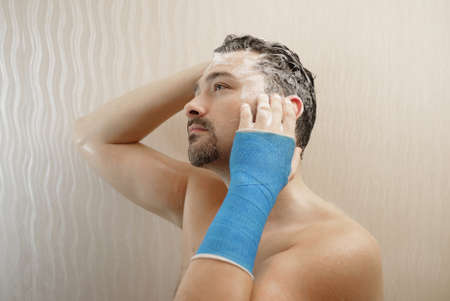 Take shower hand wrapped in synthetic cast