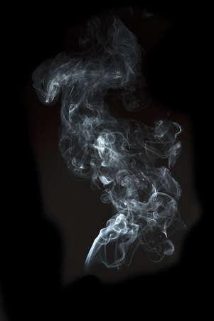 cigar smoke: the abstract white smoke on black background