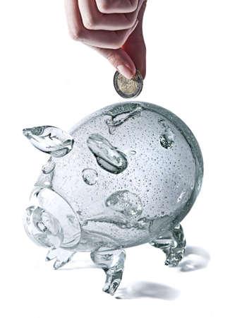 glass piggy bank on white background